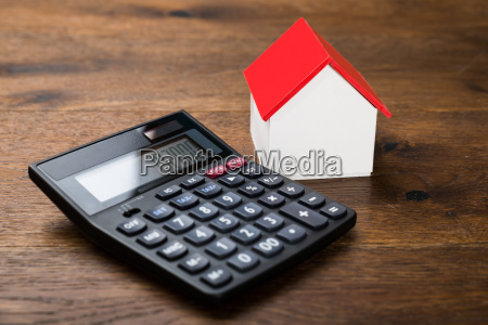miniature house with calculator