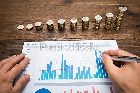 businessman analyzing financial graph