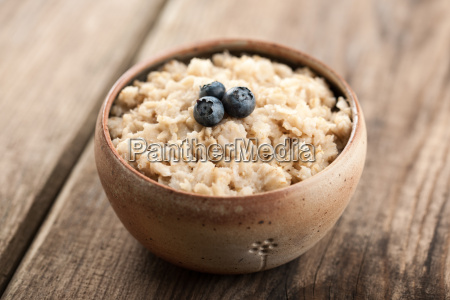 breakfast oatmeal with milk and berries