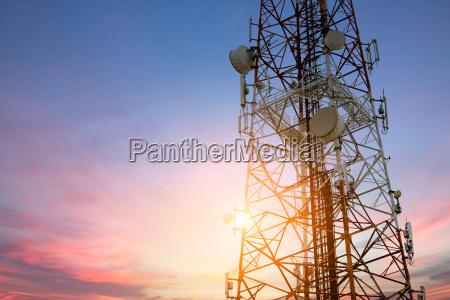 satellite dish telecom network at sunset