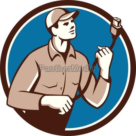 worker holding hdmi plug cord circle
