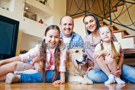young couple with daughters and dog