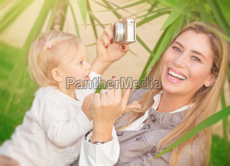 happy mother photographing baby