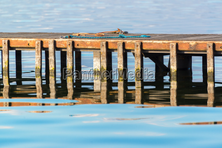 wooden pier with chords