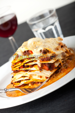 closeup of a lasagna with red