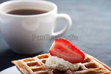 fresh waffles with a cup of
