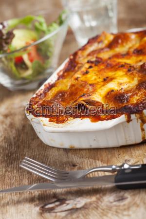 homemade lasagna on wood