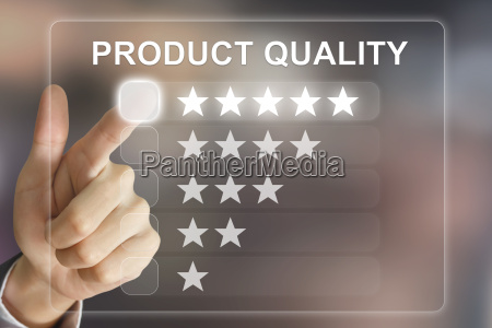 business hand pushing product quality on