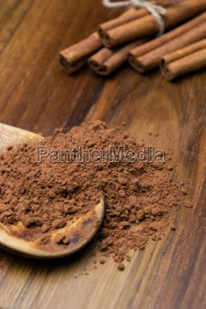 cocoa powder with cinnamon sticks on