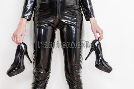 detail of standing woman wearing black
