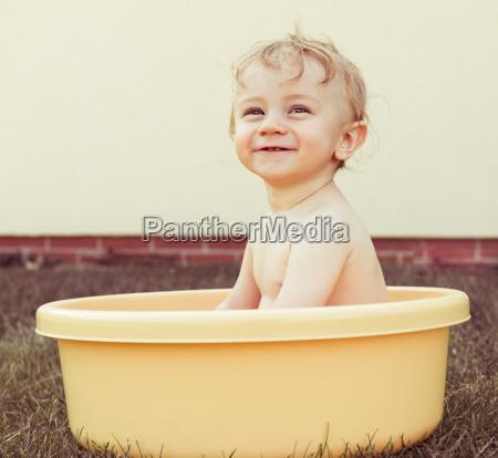 happy little baby boy having fun