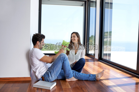 relaxed young couple at home staircase