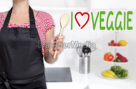 i love veggie chef holding wooden