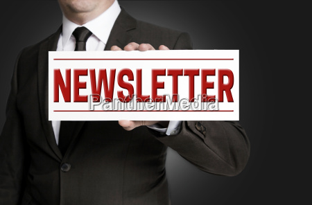 newsletter sign held by businessman
