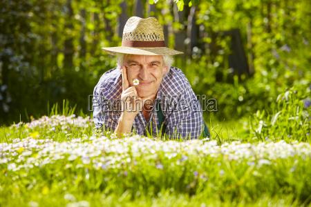 gardener flower meadow lying down