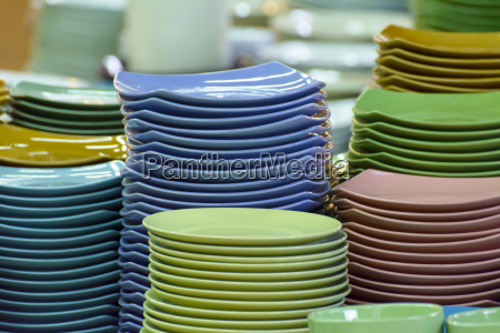 stack of multicolored plates its was