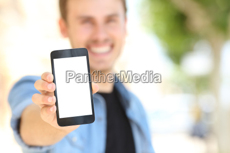 man showing a blank phone screen