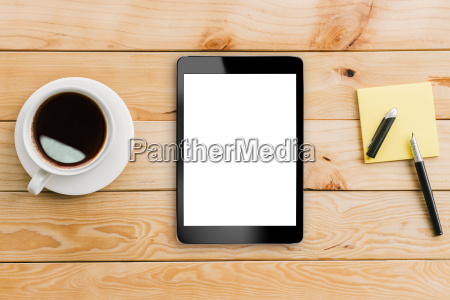 tablet white display and coffee on