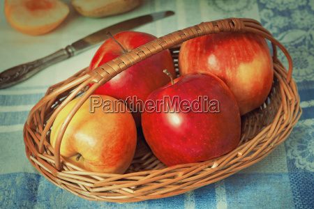 large apples in a wattled basket