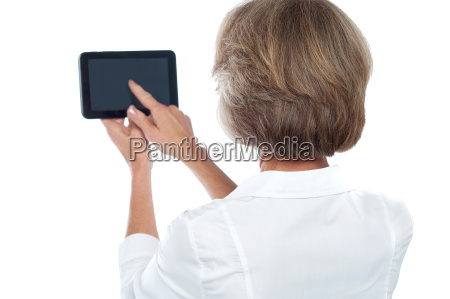 mature, woman, using, tablet, , from, back. - 14399109