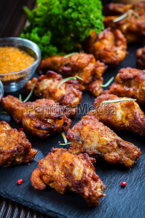chicken wings with spices and herbs