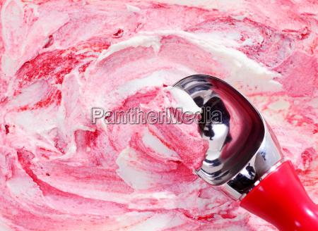 scooping berry swirl ice cream