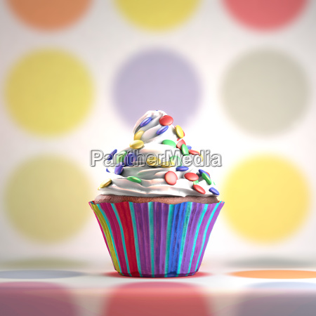 delicious cupcake with smarties on a