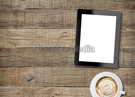 tablet white screen display and coffee