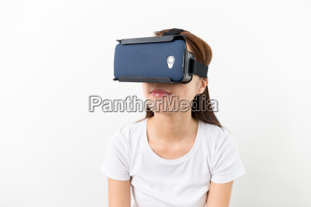 young woman watching though the vr