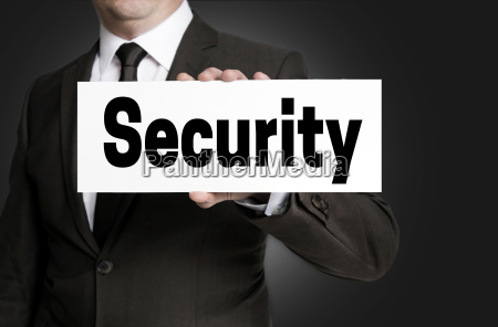 security shield is held by businessman