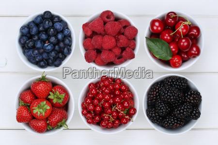 berries fruits in bowl of strawberries