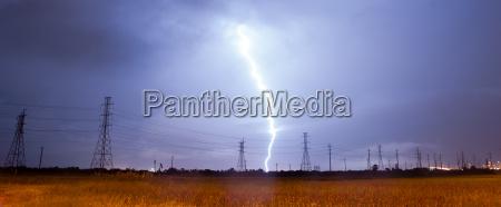 electrical storm thunderstorm lightning over power