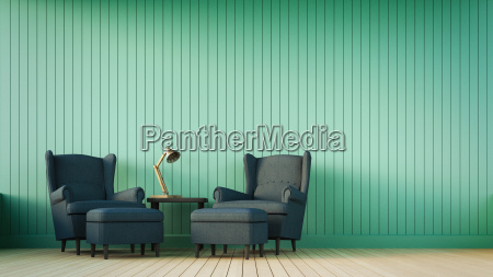 navy sofa and green wall with