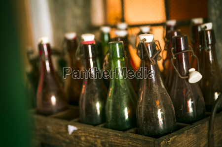 old beer bottles in a wooden