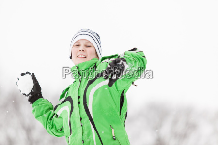 young boy enjoying the cold winter