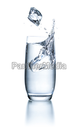 water glass with ice cubes and
