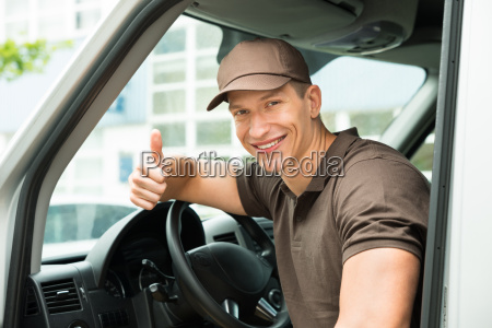 deliverymen showing thumb up sign in