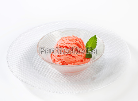 scoop of pink fruit flavored sherbet