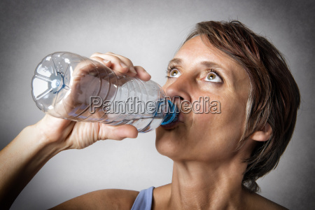 middle aged woman drinking