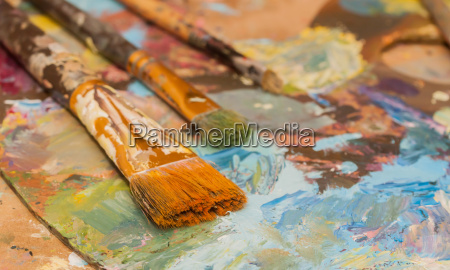 paints brushes and oil paints