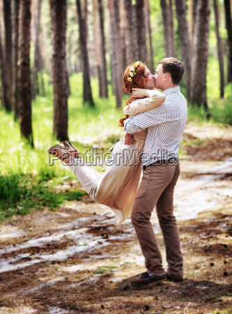 happy couple in the forest