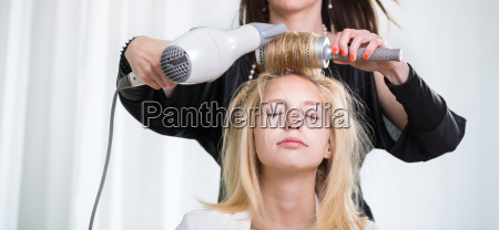 pretty young woman having her hair