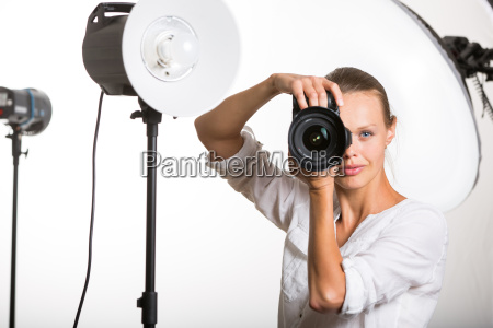 pretty female pro photographer with digital