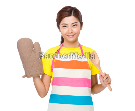 young housewife with cotton gloves and