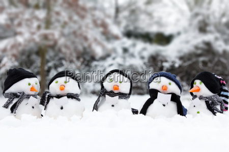 cute snowman group in snow