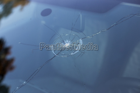 a windshield damaged by stone impact