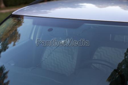 a damaged by falling rocks windshield