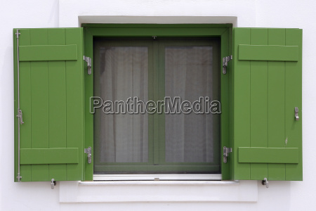 window with shutters in greece