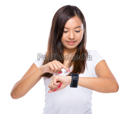 young woman use of wearable watch