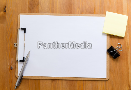 office desk with clipboard showing a